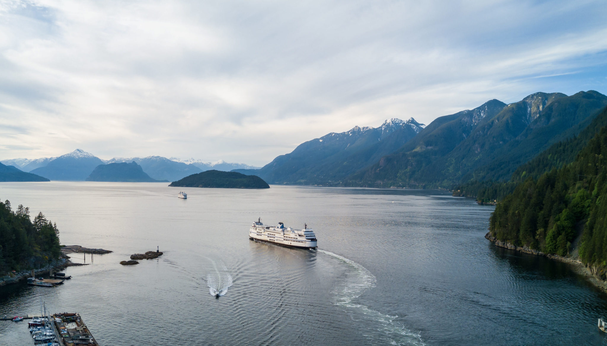 the commute and Aerial Panoramic view of Horseshoe Bay with Ferry leaving the terminal. Taken in Howe Sound, West Vancouver, British Columbia, Canada.