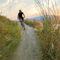 mountain biker in knox mountain kelowna central okanagan